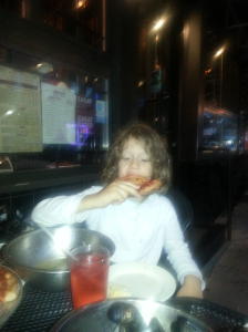 Jacob eating some Marra's Pizza