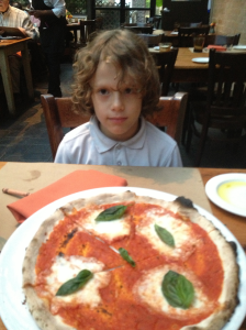 Jacob with a pizza from Osteria
